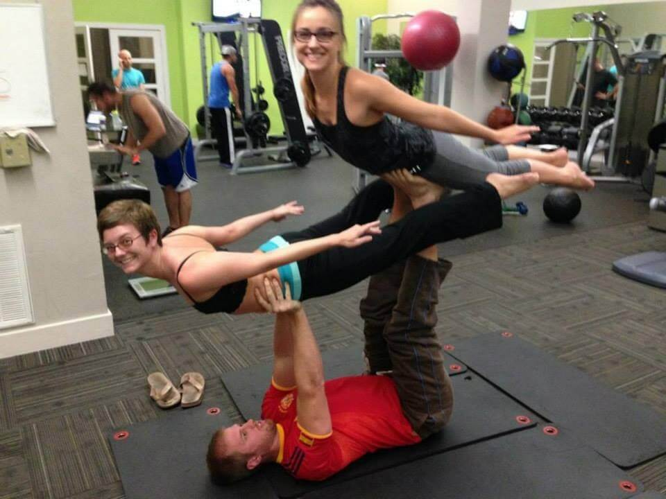 Steve doing acroyoga with his wife